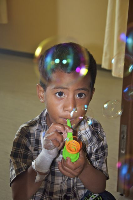 Tongan cardiac patient blowing bubbles