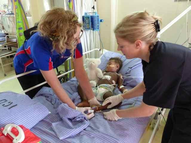 Megan helping a patient in ICU